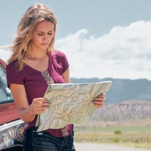 Checking the map while exploring the backroads and byways of Colorado and Utah
